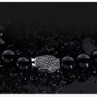 Стильный браслет на руку - черные шары на резинке