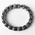 Оригинальный стальной браслет с стильными звеньями - лилиями