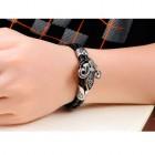 Кожаный браслет в виде кожаных жгутов и цветка - лилии
