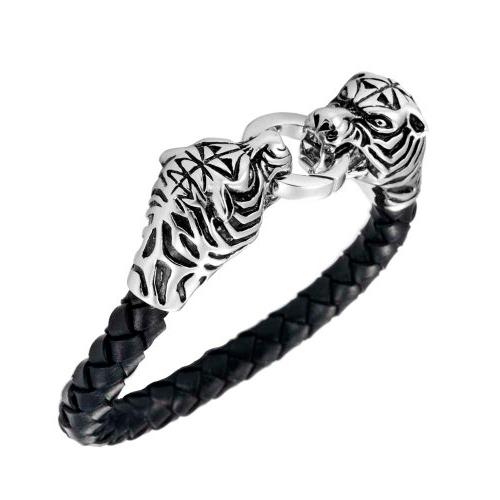 Браслет на руку в виде двух тигров, схвативших одно кольцо