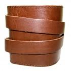 Браслет черного или коричневого цвета кожаный на липучке.