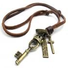 Кулон в виде ключа с королевской короной на кожаном коричневом шнурке