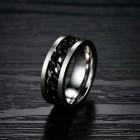 Стальное кольцо с вращающейся цепью внутри