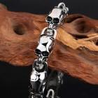 Стальной браслет из последовательных черепов на стильной застежке