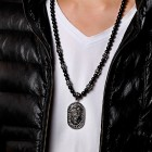 Подвеска из черных шариков на шею с медальоном в виде льва
